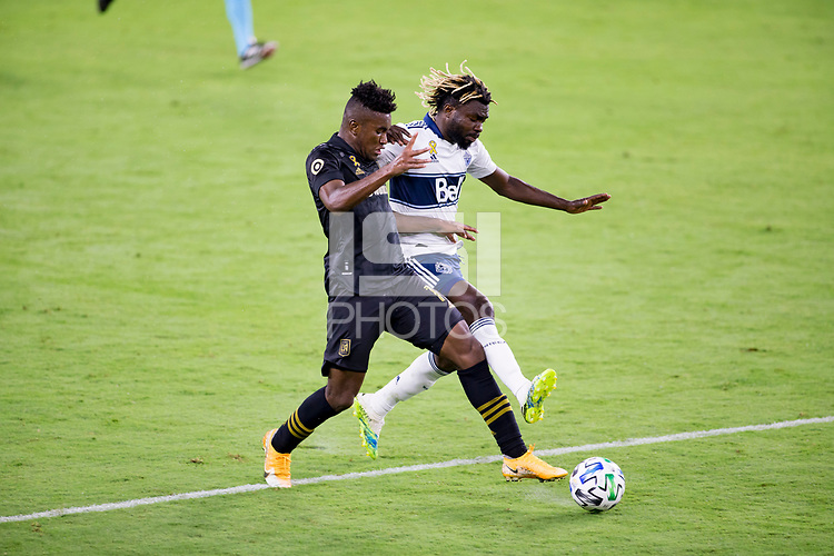LOS ANGELES, CA - SEPTEMBER 23: Jose Cifuentes #11 of LAFC and  Leonard Owusu #17 of the Vancouver Whitecaps fight for a ball during a game between Vancouver Whitecaps and Los Angeles FC at Banc of California Stadium on September 23, 2020 in Los Angeles, California.