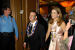 Tilman and Paige Fertitta make their entrance at the San Luis Mardi Gras Ball in Galveston Friday Feb. 01,2008.(Dave Rossman/For the Chronicle)