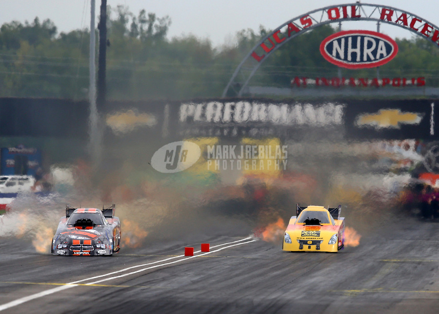 Aug 30, 2014; Clermont, IN, USA; NHRA funny car driver Bob Bode (right) races alongside Matt Hagan during qualifying for the US Nationals at Lucas Oil Raceway. Mandatory Credit: Mark J. Rebilas-USA TODAY Sports