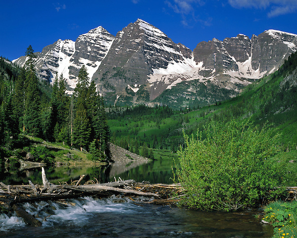 The Maroon Bells Peaks and Maroon Creek in Maroon Bells-Snowmass Wilderness Area, Aspen, Colorado, USA, .  John offers private wildflower tours in the Crested Butte area and throughout Colorado. Year-round.