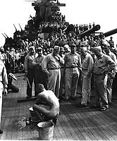 """Japanese prisoners of war are bathed, clipped, """"deloused,"""" and issued GI clothing as soon as they are taken aboard the USS NEW JERSEY.  Prisoner bathing.  December 1944.  Lt. Comdr. Charles Fenno Jacobs.  (Navy)<br /> Exact Date Shot Unknown<br /> NARA FILE #:  080-G-469956<br /> WAR & CONFLICT BOOK #:  1305"""