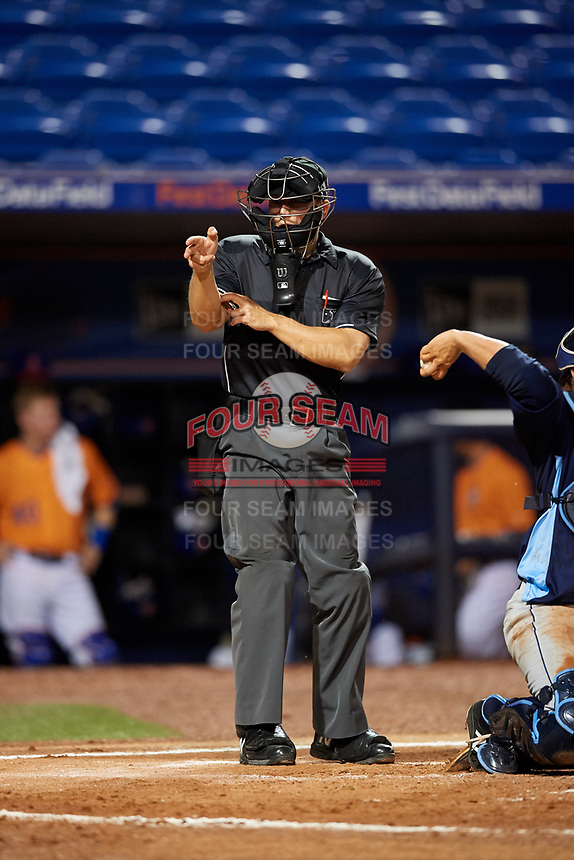 Home plate umpire Brandon Mooney calls a strike during the second game of a doubleheader between the Charlotte Stone Crabs and the St. Lucie Mets on April 24, 2018 at First Data Field in Port St. Lucie, Florida.  St. Lucie defeated Charlotte 6-5.  (Mike Janes/Four Seam Images)