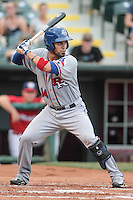 Robinson Chirinos (14) of the Round Rock Express at bat during the Pacific Coast League game against the Oklahoma City RedHawks at Chickashaw Bricktown Ballpark on June 14, 2013 in Oklahoma City ,Oklahoma.  (William Purnell/Four Seam Images)