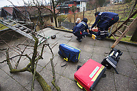 Switzerland. Canton Ticino. Comano. Paramedics team take care of an injured man during an emergency medical intervention. The man was cutting branches off a tree, fell on the ground and broke his right leg. He will be brought to hospital for medical surgery and recovery. Three paramedics wear blue uniforms and work for theCroce Verde Lugano. Both men (R) are professional certified nurses, the woman (C) is a volunteer specifically trained in emergency rescue. TheCroce Verde Lugano is a private organization which ensure health safety by addressing different emergencies services and rescue services. Volunteering is generally considered an altruistic activity where an individual provides services for no financial or social gain to benefit another person, group or organization. Volunteering is also renowned for skill development and is often intended to promote goodness or to improve human quality of life. 27.01.2018 © 2018 Didier Ruef