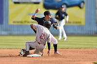 Asheville Tourists shortstop Jose Gomez (4) makes the turn on a double play over a hard sliding Santiago Espinal (2) during a game against the Greenville Drive at McCormick Field on April 15, 2017 in Asheville, North Carolina. The Tourists defeated the Drive 5-4. (Tony Farlow/Four Seam Images)