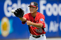 Yoon-Hee Nam #35 of the Hickory Crawdads plays catch at L.P. Frans Stadium August 9, 2009 in Hickory, North Carolina. (Photo by Brian Westerholt / Four Seam Images)