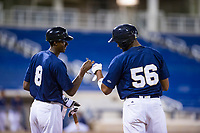 AZL Brewers first baseman Ernesto Wilson Martinez (56) talks to Je'Von Ward (8) while standing on first base during a game against the AZL Cubs on August 24, 2017 at Maryvale Baseball Park in Phoenix, Arizona. AZL Cubs defeated the AZL Brewers 9-1. (Zachary Lucy/Four Seam Images)