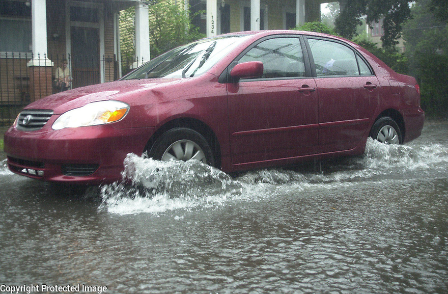 Street flooding in Lower Garden District commonly sends drivers searching for higher ground. This pic was during Isidore but is common every downpour.