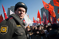 Moscow, Russia, 10/03/2012..A police offices watches as up to 20,000 people protest in central Moscow against Vladimir Putin's victory in the Russian presidential election.