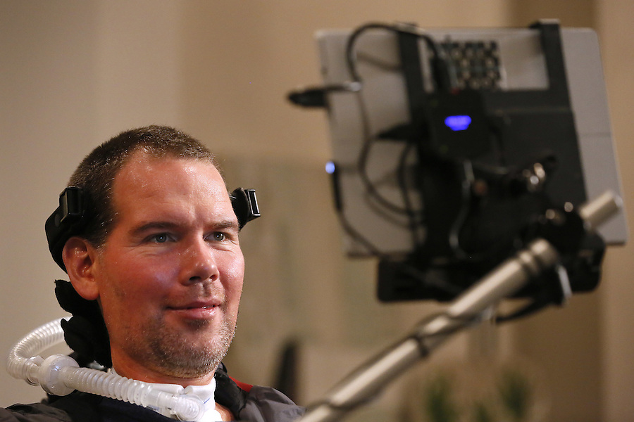In this Monday, Jan. 18, 2016 photo, former New Orleans Saints NFL football player Steve Gleason uses eye-tracking technology to communicate an answer during an interview in New Orleans. (AP Photo/Jonathan Bachman)