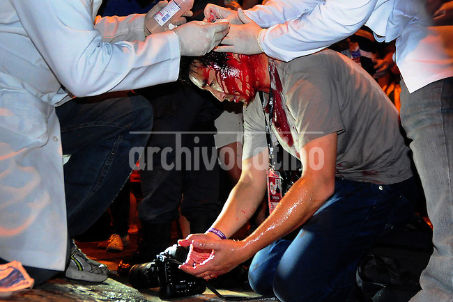 Para-medics threats the Japanese photographer Yasuyashi Chiba from Agence France Presse after he was injured during a protest outside the Guanabara Palace during the Pope Francis visit,  Rio de Janeiro, Brazil, July 22, 2013. (Austral Foto/Sandro Voxx)