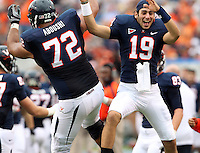Virginia Cavaliers offensive tackle Oday Aboushi (72) celebrates with Virginia Cavaliers kicker Ian Frye (19) during the game against the Southern Miss Golden Eagles at Scott Stadium. Virginia lost  30-24. (Photo/Andrew Shurtleff)