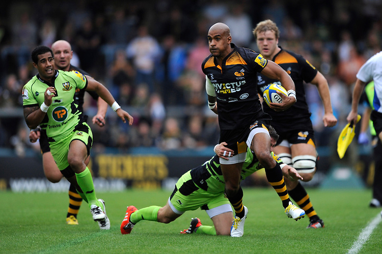 Tom Varndell of Wasps evades the tackle of Lee Dickson of Northampton Saints during the Premiership Rugby Round 2 match between Wasps and Northampton Saints at Adams Park on Sunday 14th September 2014 (Photo by Rob Munro)