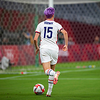 TOKYO, JAPAN - JULY 21: Megan Rapinoe #15 of the United States wide looking to make a cross during a game between Sweden and USWNT at Tokyo Stadium on July 21, 2021 in Tokyo, Japan.