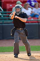 Home plate umpire Andy Draper makes a strike call during the South Atlantic League game between the Charleston RiverDogs and the Hickory Crawdads at L.P. Frans Stadium on April 29, 2012 in Hickory, North Carolina.  The Crawdads defeated the RiverDogs 12-3.  (Brian Westerholt/Four Seam Images)