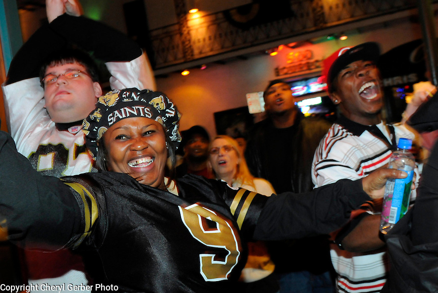New Orleans Saints fan Sandra Scott celebrates on Bourbon Street after the win of the NFC Championship game against the Minnesota Vikings,  New Orleans, Sunday, Jan. 24, 2010..(AP Photo/Cheryl Gerber)