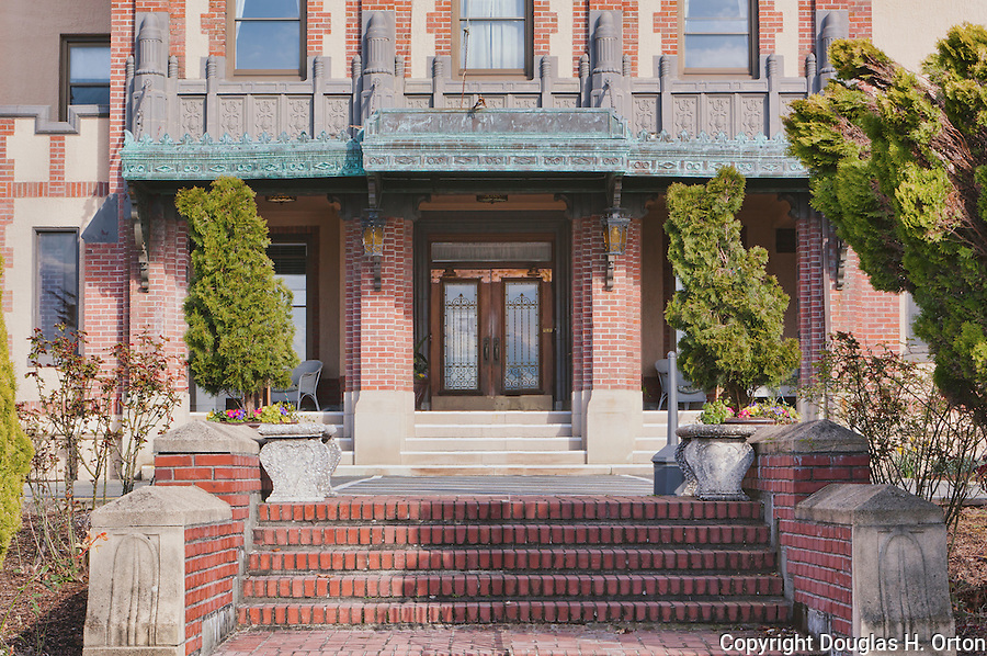 Ornate entrance to circa 1927 brick building.  Dating to 1927, the Masonic Retirement Center, locally known as the Masonic Home, in Des Moines, Washington is now an elegant event center available for rental.  In the historic Zenith neighborhood of the city of Des Moines. Please contact douglasorton@comcast.net regarding licensing of this image.
