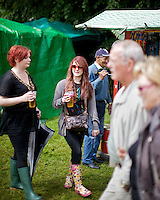 Young spectators drink beer at the Inveraray Highland Games, held at Inveraray Castle in Argyll.