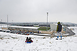 Northampton Town 1 Oxford United 0, 23/03/2013. Sixfields, League Two. Oxford United are the visitors to Sixfields as the long British winter continues in Northamptonshire. A glimse of the action from the snowy bank outside Sixfields. Photo by Simon Gill