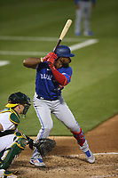 OAKLAND, CA - MAY 3:  Teoscar Hernández #37 of the Toronto Blue Jays bats against the Oakland Athletics during the game at the Oakland Coliseum on Monday, May 3, 2021 in Oakland, California. (Photo by Brad Mangin)
