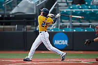 Pres Cavenaugh (29) of the UNCG Spartans follows through on his swing against the San Diego State Aztecs at Springs Brooks Stadium on February 16, 2020 in Conway, South Carolina. The Spartans defeated the Aztecs 11-4.  (Brian Westerholt/Four Seam Images)