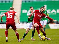 6th February 2021; Easter Road, Edinburgh, Scotland; Scottish Premiership Football, Hibernian versus Aberdeen; Jackson Irvine of Hibernian and Fraser Hornby of Aberdeen compete for possession of the ball