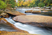 Just above the Lower Ammonoosuc Falls  on the Ammonoosuc River in Carroll, New Hampshire USA during autumn months. The Cohos Trail passes by this view.