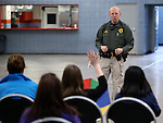 Carson City Sheriff's Deputy Darin Riggins speaks at a K-9 team demonstration for a group of GATE students from Carson Middle and Eagle Valley Middle schools, on Wednesday, March 5, 2014 at Fuji Park.<br /> Photo by Cathleen Allison/Nevada Photo Source