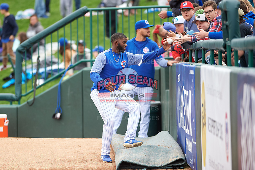 South Bend Cubs Delvin Zinn (3) gives a ball to a fan during a Midwest League game against the Cedar Rapids Kernels at Four Winds Field on May 8, 2019 in South Bend, Indiana. South Bend defeated Cedar Rapids 2-1. (Zachary Lucy/Four Seam Images)