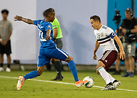 CHARLOTTE, NC - JUNE 23: Romario Barthelery #22 defends against Andres Guardado #18 during a game between Mexico and Martinique at Bank of America Stadium on June 23, 2019 in Charlotte, North Carolina.
