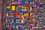 """The colourful canopies of market stalls at a centuries old fish festival resemble beach towels from above in this vibrant scene from Bogura, Bangladesh.<br /> <br /> The drone shots were captured by Azim Khan Ronnie,  34, a freelance photographer from Dhaka.<br /> <br /> Azim said, """"this ancient fish fair, on the banks of the Ichhamati River, has been held for more than 400 years.  It is only held for one day, and people travel from all over the country to experience it.""""<br /> <br /> """"One of the main attractions is the sheer variety of fish on offer.  It also serves as a meeting place for all religions, tribes and faiths.  The economic importance can't be underestimated either; the lower classes benefit greatly from the sales they make.""""<br /> <br /> Please byline: Azim Khan Ronnie /Solent News<br /> <br /> © Azim Khan Ronnie /Solent News & Photo Agency<br /> UK +44 (0) 2380 458800"""