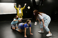 """Summer Programs Manager Alexa Bella (right) observes as Addie Lundy (from top down), Gabrielle Mason and Amelia Adams participate in an exercise creating tableaus, an acting method creating frozen pictures on stage, Monday, July 19, 2021 at Trike Theater in Bentonville. Local high schoolers participated in a two week, self-devised camp in preparation for a senior performance of Tiger In My Suit. The students use different acting strategies to create stories and unpack emotions through theater, said Alexa Bella, the summer programs manager. """"We're just excited to be back from last year being fully virtual,"""" she said. """"It's a little hard getting everyone out of their shells on Zoom. It's their first summer hosting camps in their new building. Check out nwaonline.com/210720Daily/ for today's photo gallery. <br /> (NWA Democrat-Gazette/Charlie Kaijo)"""