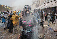 Pictured: A flour wars participant in Galaxidi, Greece. Monday 19 February 2018<br /> Re: Clean Monday (Monday of Lent) celebration of flour wars (Alevromoutzouroma) in the town of Galaxidi, which coincides with the beginning of the Greek Orthodox Lent in Greece. The origins of the custom are unclear, however it appears in its current form since the mid-19th century.<br /> Locals and visitors of all ages gather to collect large quantities of flour which they throw to each other. Various types of coloring is added for effect while people paint their faces with charcoal.