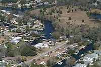 coastal development, showing canals, important Florida manatees' wintering habitat, surrounded by residential homes, Crystal River, Florida, USA