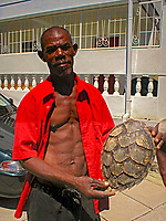 a Dominican holding a sea turtle shell, Dominica, Caribbean, Atlantic