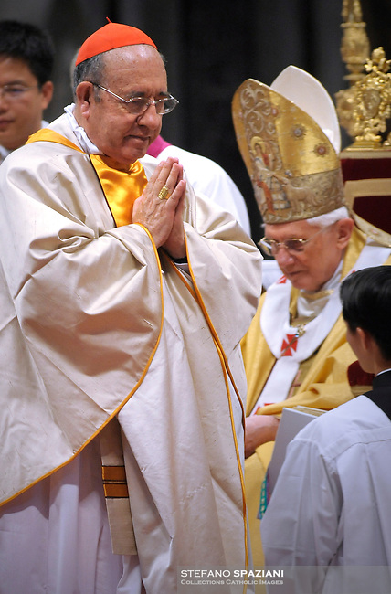 .Pope Benedict XVI (L) gives his cardinal ring to Ecuadorian Raul Eduardo vela Chiriboga (R) during the Eucharistic celebration with the new cardinals on November 21, 2010 at St Peter's basilica at The Vatican. 24 Roman Catholic prelates joined the day before the Vatican's College of Cardinals, the elite body that advises the pontiff and elects his successor upon his death.