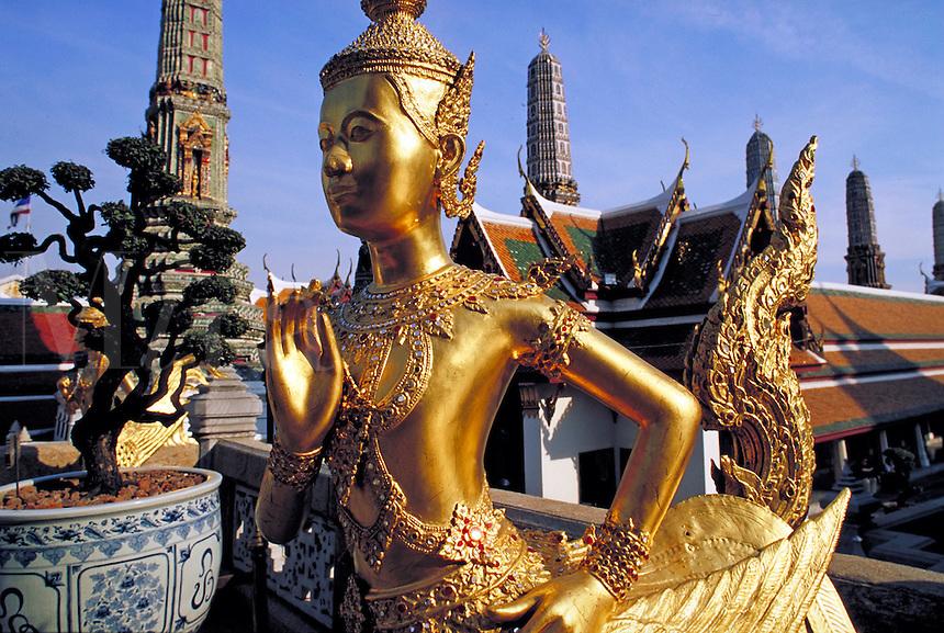 Gold statue at Grand Palace. Bangkok, Thailand.