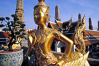 Gold statue at Grand Palace. Bangkok, Thailand.