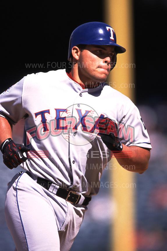 Ivan Rodriguez of the Texas Rangers during a 2000 season MLB game at Angel Stadium in Anaheim, California. (Larry Goren/Four Seam Images)