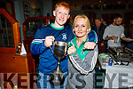 Na Gaeil footballer Dan Goggin holding the All Ireland Junior championship Cup, standing with his mom Fiona Kelly in the clubhouse on Saturday night