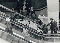 1989 FILE PHOTO - ARCHIVES -<br /> <br /> Man falls at Eaton Centre. Vincent Gray; 23; is carried away on a stretcher after falling three storeys in the mall of the Eaton Centre yesterday. He was able to hold on to a railing briefly; but then lost his grip. Police and ambulance responded and the man was taken to Toronto General Hospital with leg and internal injuries. He is reported in good condition.