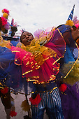 Rio de Janeiro, Brazil. Mal samba dancer during the carnival parade at the Sambadrome.