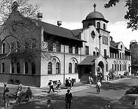 Men and Women leaving the Main Office Building. <br /> Date: ca 1955<br /> Prints Admin Pueblo Box 8