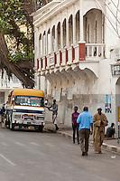Senegal, Saint Louis.  Street Scene, Colonial Architecture, Pedestrians, Local Transport.