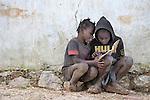 Children do their school homework in the mountainous community of Foret-des-Pins, Haiti.