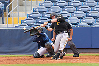 FCL Pirates Black Henry Davis (32) hits a two run home run, the first of his professional career, to opposite field in the top of the fourth inning during a game against the FCL Rays on August 3, 2021 at Charlotte Sports Park in Port Charlotte, Florida.  Davis was making his professional debut after being selected first overall in the MLB Draft out of Louisville by the Pittsburgh Pirates.  Catching is Roberto Alvarez (91), umpire is Nobuoki Yasuta.  (Mike Janes/Four Seam Images)