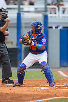 Kingsport Mets catcher Dionis Rodriguez (12) checks the runner at first during the game against the Elizabethton Twins at Hunter Wright Stadium on July 8, 2015 in Kingsport, Tennessee.  The Mets defeated the Twins 8-2. (Brian Westerholt/Four Seam Images)