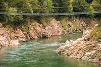 People on swingbridge over Buller River near Murchison, Buller Region, West Coast, New Zealand