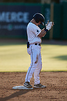 Ben Troike (11) of the Charleston RiverDogs claps his hands after hitting a double against the Down East Wood Ducks during the Low-A East Championship game at Joseph P. Riley, Jr. Park on September 26, 2021 in Charleston, South Carolina. (Brian Westerholt/Four Seam Images)
