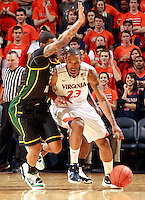 CHARLOTTESVILLE, VA- DECEMBER 6: Mike Scott #23 of the Virginia Cavaliers drives past Ryan Pearson #24 of the George Mason Patriots during the game on December 6, 2011 at the John Paul Jones Arena in Charlottesville, Virginia. Virginia defeated George Mason 68-48. (Photo by Andrew Shurtleff/Getty Images) *** Local Caption *** Mike Scott;Ryan Pearson